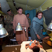 """Pakistani Presedent Pervez Musharraf visits the U.S. M.A.S.H. and offers his prayers and money to the patients here.  <br /> Baby Bilal Nasir and his parents came to the U.S. M.A.S.H. in Muzaffarabad for medical treatment.<br /> The father, Nasir Kahn, said the visit by President Musharraf was """"a dream come true."""""""