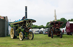 © Licensed to London News Pictures. 01/08/2013<br /> <br /> Pickering, Yorkshire, United Kingdom<br /> <br /> Traction engines on display at the 61st annual Pickering traction engine rally in North Yorkshire. The event has the largest line up of Showman's engines and fairground organs in the north of England and boasts over a thousand vintage and classic cars, commercials, tractors and motorcycles, arena attractions, a fun fair, steam rollers, steam ploughing and along with food and craft marquees the event is the largest event of it's type in the north of England.<br /> <br /> Photo credit : Ian Forsyth/LNP© Licensed to London News Pictures. 01/08/2013