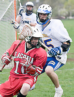 Laconia's Justin Degara gets around Gilford's Christian Bua during the Division III Boys Lacrosse held at the Meadows field in Gilford on Thursday afternoon.  The final tally Laconia 15 / Gilford 3.   (Karen Bobotas/for the Laconia Daily Sun)