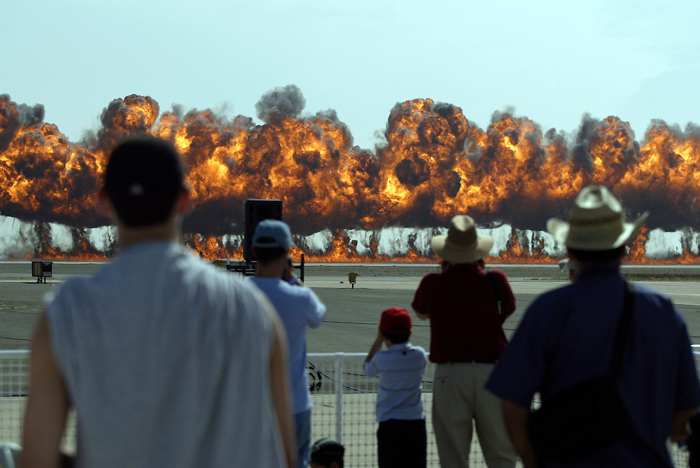 SAN DIEGO, CA - OCTOBER 15, 2004:  Spectators watch the explosions from a mock attack at the Miramar Air Show on October 15, 2004, in San Diego, CA. (Photo by Todd Bigelow/Aurora)