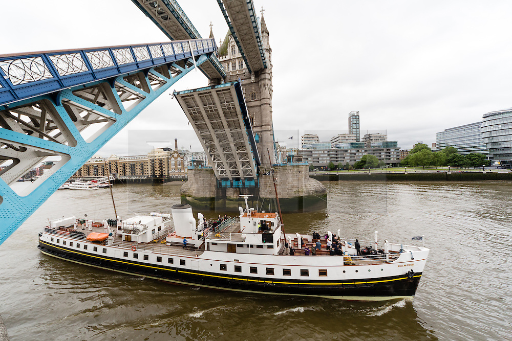 © Licensed to London News Pictures. 31/05/2016. LONDON, UK.  MV Balmoral arrives in central London under Tower Bridge during rainy, windy weather today. Popular heritage excursion ship MV Balmoral has returned to the Thames for the first time since 2012. The ship, listed on the National Historic Fleet register, was laid up in 2013 and her future looked uncertain but a Bristol-based charity was formed to preserve the vessel and return to her use. She will be undetaking journeys up and down the Thames and around the coast throughout June.  Photo credit: Vickie Flores/LNP