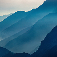 Haze from the plains of India creeps into the canyon of the Dudh Kosi River in the Khumbu region of Nepal's Himalaya.