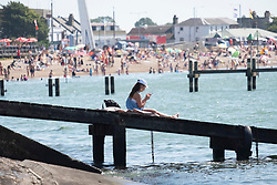 © Licensed to London News Pictures. 31/07/2020. Southend, UK. A young woman enjoys the Southend-on-Sea beach as social distancing measures are relaxed and temperatures are expected to be over 30c. British holiday makers have chosen to book staycations in the UK as the uncertainty of Covid-19 lockdown looms. Photo credit: Ray Tang/LNP