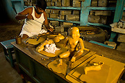 A craftsman carves an icon from wax in the workshops of the Stpathy family of bronze statue makers in Swamimalai, India.The current Stpathy family is the twenty third generation of bronze casters dating back to the founding of the Chola Empire. The Stapathys had been sculptors of stone idols at the time of Rajaraja 1 (AD985-1014) but were called to Tanjore to learn bronze casting. Their methods using the ,?Úlost wax,?Ù process remains unchanged to this day..
