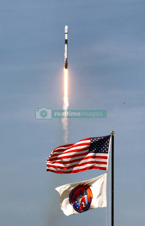 NO FILM, NO VIDEO, NO TV, NO DOCUMENTARY - A SpaceX Falcon 9 sails past the American and mission flags as it lifts off from Launch Pad 39-A at Kennedy Space Center, Tuesday, May 4, 2021. Designated as Starlink V1.0-L25, the rocket carries a payload with the 26th batch of 60 satellites to be deployed for SpaceX's ongoing expansion of their Starlink broadband network. Photo by Joe Burbank/Orlando Sentinel/TNS/ABACAPRESS.COM