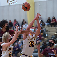 Rehoboth Lynx Jake Zylstra (32) reaches for a rebound as Shiprock Chieftain Shannon Dale (32) knocks the ball away Tuesday at Rehoboth Christian School in Rehoboth.