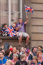 © Licensed to London News Pictures. 10/09/2012. LONDON, UK. Spectators are seen near Bank Station in London today (10/09/12) during a parade made up of British athletes who competed in the London 2012 Olympic and Paralympic Games. Photo credit: Matt Cetti-Roberts/LNP
