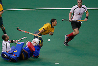 10th Men's World Cup Fieldhockey. South Africa vs Germany (0-3). South African forward Bruce Jacobs (m) is stopped by German goalkeeper Clemens Arnold.  left Jamilon Mulders (Ger), right Florian Kunz (Ger)