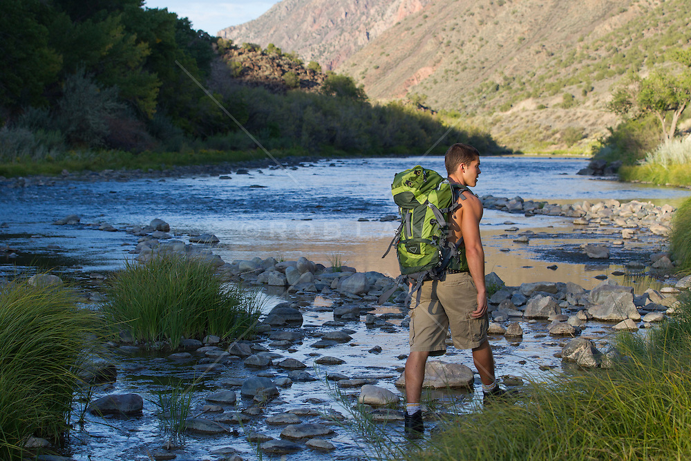 sexy young hiker walking the Rio Grande in New Mexico