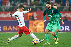 Wroclaw, Poland - 2016 November 14: (L) Damian Dabrowski of Poland fights for the ball with (R) Rok Kronaveter of Slovenia during Poland v Slovenia - International Friendly Soccer Match at Municipal Stadium on November 14, 2016 in Wroclaw, Poland.<br /> <br /> Adam Nurkiewicz declares that he has no rights to the image of people at the photographs of his authorship.<br /> <br /> Picture also available in RAW (NEF) or TIFF format on special request.<br /> <br /> Any editorial, commercial or promotional use requires written permission from the author of image.<br /> <br /> Mandatory credit:<br /> Photo by © Adam Nurkiewicz / Mediasport