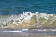 Small beach wave on the sand