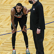 ORLANDO, FL - APRIL 12: San Antonio Spurs head coach Gregg Popovich jokes with Dejounte Murray #5 of the San Antonio Spurs during a game against the Orlando Magic in the second half at Amway Center on April 12, 2021 in Orlando, Florida. NOTE TO USER: User expressly acknowledges and agrees that, by downloading and or using this photograph, User is consenting to the terms and conditions of the Getty Images License Agreement. (Photo by Alex Menendez/Getty Images)*** Local Caption *** Gregg Popovich; Dejounte Murray