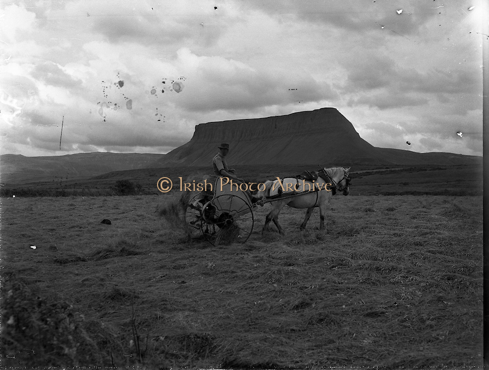 Views - Ben Bulben, Co. Sligo <br /> 25/04/1957<br /> Since posting this image we found that the gentleman in this beautiful image is in fact Tom Stewart, Munninane, Grange, Co. Sligo.<br /> His Grand-daughter Emer Woods contacted me after the Sligo Champion ran a piece and used this image to illustrate it!  <br /> Emer and her family are delighted to have found the image and Irish Photo Archive are delighted to have been able to provide it!!