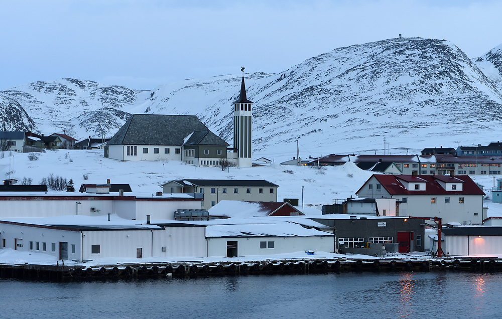The quay and Mehamn Chapel. The village is on the Nordkinn Peninsula at the southern end of the Mehamnfjorden, which opens into the Barents Sea. Mehamn, Finnmark, Norway.