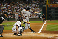 CHICAGO - OCTOBER 25:  Joe Crede #24 of the Chicago White Sox hits a solo home run in the fifth inning during Game 3 of the 2005 World Series against the Houston Astros at Minute Maid Field on October 25, 2005 in Chicago, Illinois.  The White Sox defeated the Astros 7-5.