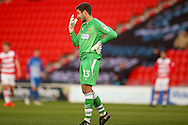 Doncaster Rovers goalkeeper Marko Marosi (13) complains vision problems and subsequently has to be substituted for Doncaster Rovers goalkeeper Ross Etheridge (1)  during the EFL Sky Bet League 2 match between Doncaster Rovers and Hartlepool United at the Keepmoat Stadium, Doncaster, England on 19 November 2016. Photo by Simon Davies.