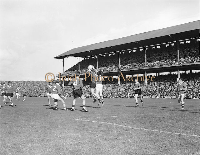 Players from each team fight for possession in the air during the All Ireland Senior Gaelic Football Final Down v Offaly in Croke Park on 28th September 1969.