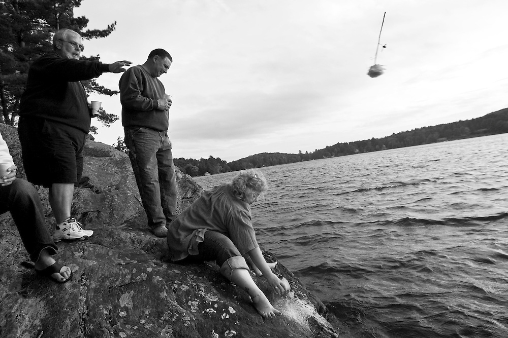 Sept. 22, 2009 - Marie's husband Paul tosses a yellow rose into the lake surrounding Marie's favorite vacation spot in Vermont as her daughter Marcie scatters her ashes.