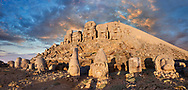 Statue heads at sunset, from right,  Lion, Eagle, Herekles, Apollo, Zeus, Commagene, Antiochus, & Eagle, with headless seated statues in front of the stone pyramid 62 BC Royal Tomb of King Antiochus I Theos of Commagene, east Terrace, Mount Nemrut or Nemrud Dagi summit, near Adıyaman, Turkey .<br /> <br /> If you prefer to buy from our ALAMY PHOTO LIBRARY  Collection visit : https://www.alamy.com/portfolio/paul-williams-funkystock/nemrutdagiancientstatues-turkey.html<br /> <br /> Visit our CLASSICAL WORLD HISTORIC SITES PHOTO COLLECTIONS for more photos to download or buy as wall art prints https://funkystock.photoshelter.com/gallery-collection/Classical-Era-Historic-Sites-Archaeological-Sites-Pictures-Images/C0000g4bSGiDL9rw
