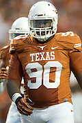 AUSTIN, TX - AUGUST 31: Malcom Brown #90 of the Texas Longhorns looks on against the New Mexico State Aggies on August 31, 2013 at Darrell K Royal-Texas Memorial Stadium in Austin, Texas.  (Photo by Cooper Neill/Getty Images) *** Local Caption *** Malcom Brown