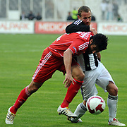 Besiktas's Michael FINK (B) and Sivasspor's Sedat BAYRAK (F) during their Turkish superleague soccer match Besiktas between Sivasspor at BJK Inonu Stadium in Istanbul Turkey on Saturday, 24 April 2010. Photo by TURKPIX