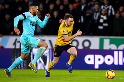 Diogo Jota of Wolverhampton Wanderers takes on Jamaal Lascelles of Newcastle United - Mandatory by-line: Robbie Stephenson/JMP - 11/02/2019 - FOOTBALL - Molineux - Wolverhampton, England - Wolverhampton Wanderers v Newcastle United - Premier League