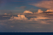 Clouds gathering at dusk over Burbo Bank Offshore Wind farm located on the Burbo Flats in Liverpool Bay in the Irish Sea. The 90 MW facility began generating power in July 2007 with a 25 year life expectancy.