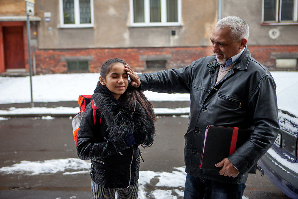 """Rachel Klemparova (9) with her father Miroslav Klempar talking about what happened in school that day. Both are standing in the street where the family lives in Ostrava. Rachel visits the 4th class at the """"Nadrazni"""" school in Ostrava where Roma and non Roma children are educated together."""