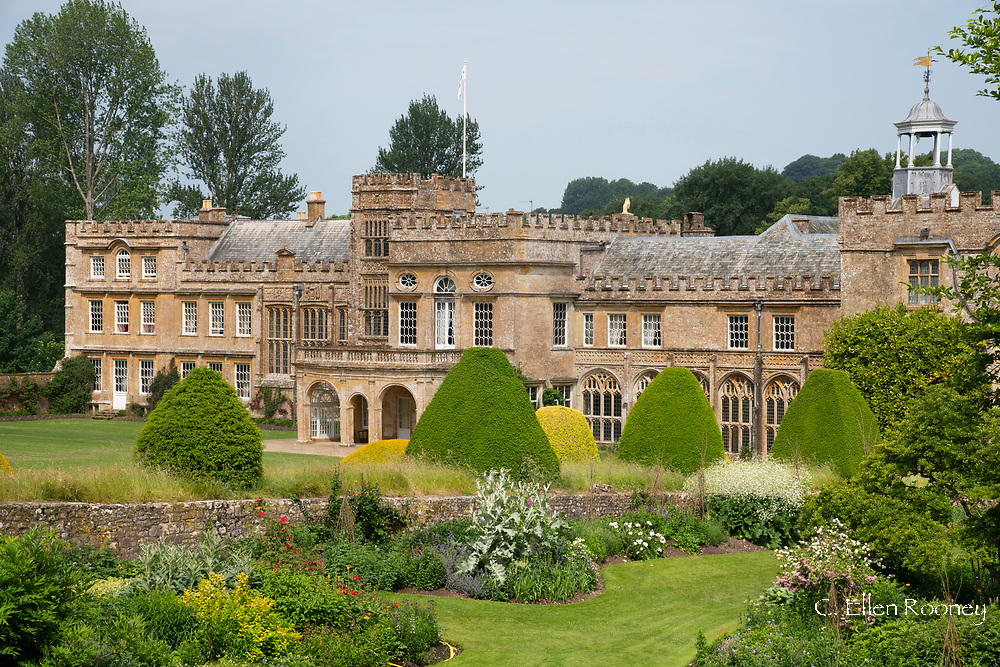 Forde Abbey, a former Cistercian monastery surrounded by Yew topiary and borders in  Chard, Dorset, UK