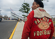 Lou Scott, of Palmyra, wears his 1978 State Championship jacket on his way to the stadium as Palmyra and Burlington City football play for the 111th time, Thursday, November 27, 2014. Photo by Bryan Woolston / @woolstonphoto.