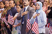 July 4, 2008 -- Phoenix, AZ: NAHLA SANCOUR, (RIGHT) originally from Iran, and other new US citizens take the oath of citizenship at a naturalization ceremony in Phoenix, AZ, Friday. About 300 people from 41 countries were naturalized as US citizens at South Mountain Community College, in Phoenix, AZ, Friday. It was the 20th year the college has hosted the Fiesta of Independence. More than 5,000 people have become naturalized US citizens at the Fiesta of Independence. More than 5,000 people have become naturalized US citizens at the Fiesta of Independence. The largest number of new citizens, 158, came from Mexico. There were also large numbers of new citizens from the Philippines, Bosnia-Herzegovnia and India.  Photo by Jack Kurtz