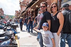 Jasmin, Henry and Holger Mohr on Main Street in Deadwood during the annual Sturgis Black Hills Motorcycle Rally. Deadwood, SD, USA. Monday August 7, 2017.  Photography ©2017 Michael Lichter.