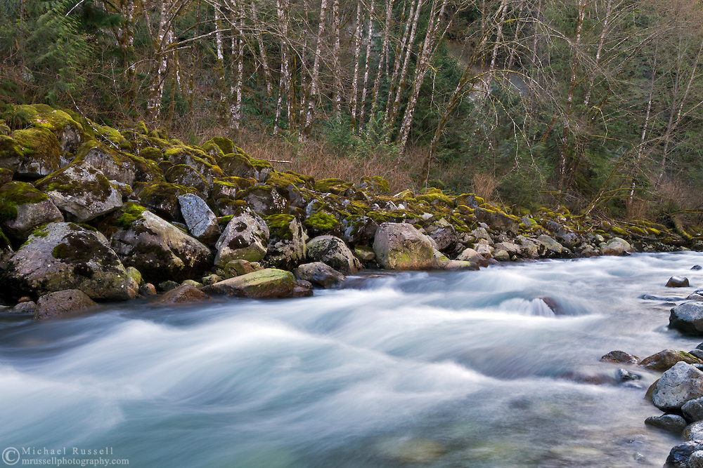 The blue waters of Gold Creek cascade through Golden Ears Provincial Park in Maple Ridge, British Columbia, Canada