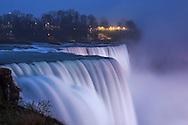The American Falls on a rainy, foggy winter evening at Niagara Falls, New York State, USA
