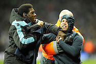 a Aston Villa fan is dragged away by Aston Villa Security/stewards at the end of match . The FA cup, 6th round match, Aston Villa v West Bromwich Albion at Villa Park in Birmingham, Midlands on Saturday 7th March 2015<br /> pic by John Patrick Fletcher, Andrew Orchard sports photography.