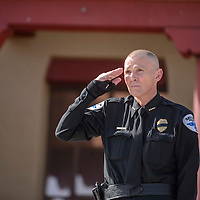 052915       Adron Gardner<br /> <br /> Police chief Robert Cron salutes during the Gallup Police Department Fallen Officer's Memorial at the McKinley County Courthouse in Gallup Friday.