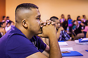 """18 AUGUST 2012 - PHOENIX, AZ:  A man prays at the beginning of a deferred action workshop in Phoenix. More than 1000 people attended a series of 90 minute workshops in Phoenix Saturday on the """"deferred action"""" announced by President Obama in June. Under the plan, young people brought to the US without papers, would under certain circumstances, not be subject to deportation. The plan mirrors some aspects the DREAM Act (acronym for Development, Relief, and Education for Alien Minors), that immigration advocates have sought for years. The workshops were sponsored by No DREAM Deferred Coalition.  PHOTO BY JACK KURTZ"""
