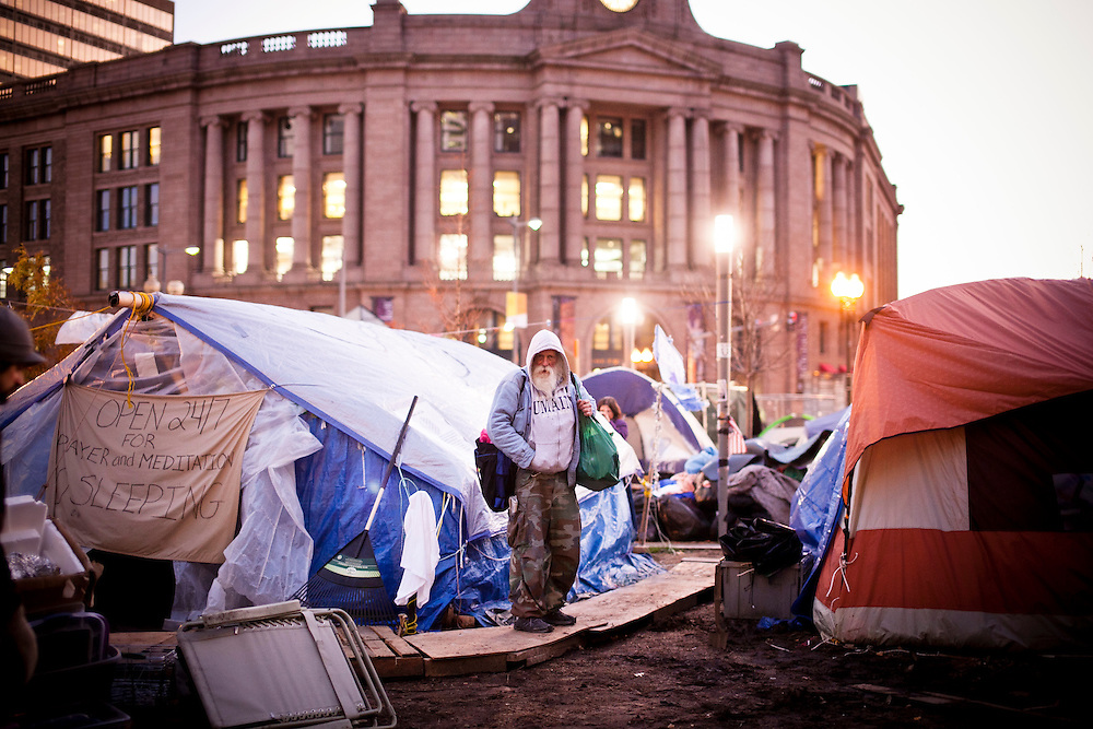 A man wanders inside the camp of Occupy Boston in Boston, Massachusetts, December 8, 2011.