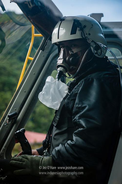 Capt. Adhian P. Armun in a Bell helicopter at Tembagapura helipad, Papua, Indonesia.