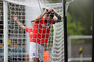 Brighton & Hove Albion defender Shane Duffy (22) hangs in the net after going close during the EFL Sky Bet Championship match between Burton Albion and Brighton and Hove Albion at the Pirelli Stadium, Burton upon Trent, England on 17 September 2016.