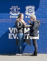 Two fans eat their fish and chips outside Goodison Park, home of Everton FC<br /> <br /> Photographer Stephen White/CameraSport<br /> <br /> Football - Barclays Premiership - Everton v Burnley - Saturday 18th April 2015 - Goodison Park - Everton<br /> <br /> © CameraSport - 43 Linden Ave. Countesthorpe. Leicester. England. LE8 5PG - Tel: +44 (0) 116 277 4147 - admin@camerasport.com - www.camerasport.com