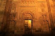 Moorish doorway arch elaborately inscribed stonework of the mezquita, Cordoba, Spain