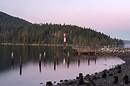 The lighthouse at Barnet Marine Park on Burrard Inlet in Burnaby, British Columbia, Canada. The cement structure on the right is the remains of the old scrap burner for a lumber mill that used to be on the site until 1958.