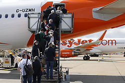 © Licensed to London News Pictures. 17/05/2021. Crawley, UK. Air passengers board an EasyJet flight to Faro, Portugal from Gatwick Airport south of London as step three on the roadmap out of lockdown starts. Travel to 12 countries on the green list is allowed from today. Holiday-makers returning home from green listed countries, including Portugal, Gibraltar and Iceland will not have to self-isolate on return. Various hospitality rules are also changing today - with pubs and restaurants allowed to serve seated customers indoors. Photo credit: Peter Macdiarmid/LNP