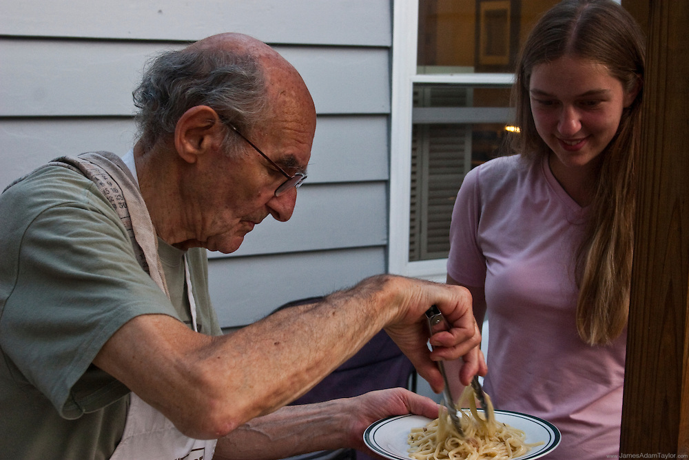 Bill serving a plate of spaghetti to Southbound hiker Castle at the Outhouse Hiker Hostel, Unionville, NY.