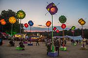 The umbrella sculptures in teh arena light up at night - The 2018 Latitude Festival, Henham Park. Suffolk 14 July 2018