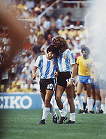 Diego Maradona (Arg) is consoled by Alberto Tarantini after being sent off. Argentina v Brazil World Cup Finals 1982 Spain Credit : Colorsport / Andrew Cowie