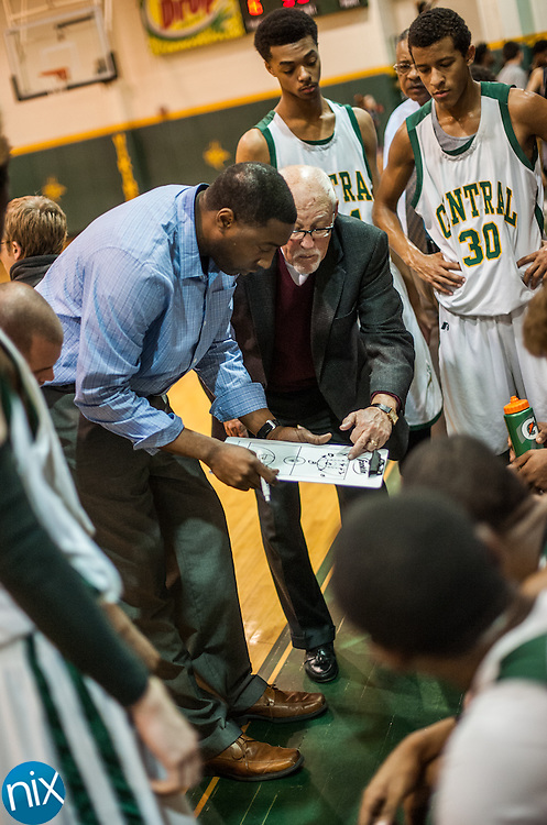 New Central Cabarrus head coach Kenyan Weaks talks with his team during a timeout to against Northwest Cabarrus Friday night at Central Cabarrus High School. Central won the game 47-46.
