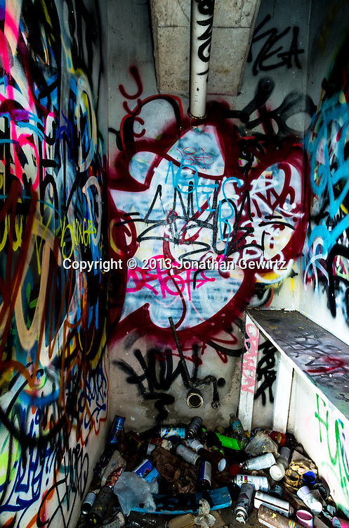 Miami's Marine Stadium on Virginia Key is located next to a U-shaped lagoon once used for powerboat racing. The stadium was damaged in the 1992 hurricane and abandoned. Since then it has been a favorite venue for graffiti artists and urban explorers. WATERMARKS WILL NOT APPEAR ON PRINTS OR LICENSED IMAGES.