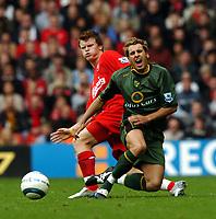 John Arne Riise Liverpool/Darren Huckerby Norwich City<br />Liverpool v Norwich City 25/09/04<br />The Premier League<br />Photo Robin Parker